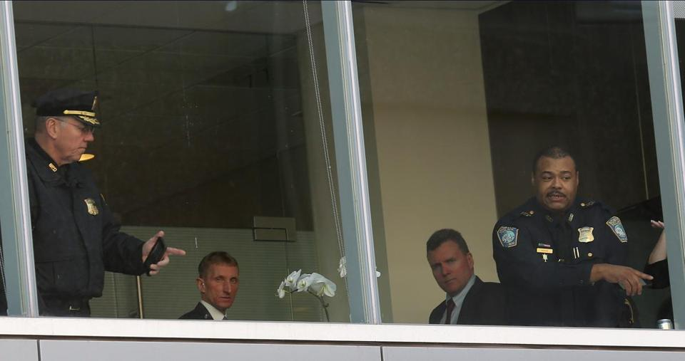 Boston Police Superintendent in Chief William Gross (right) and Commissioner William Evans (second from left) were on the second floor of the Brigham after the shooting.
